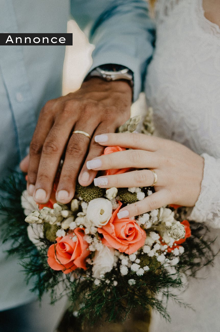man and woman s hands on top of ball bouquet